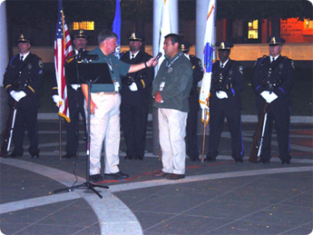 Chief Moreno is reading Officer Morton's name during the reading of the names of by agency's
